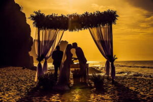 silhouette of a couple kissing in front of sunset Destination Wedding In North Queensland