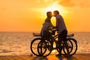 a couple had Beach Wedding Queensland and kissing in front of golden sunset