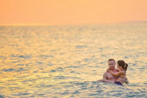 couple swimming at the beach