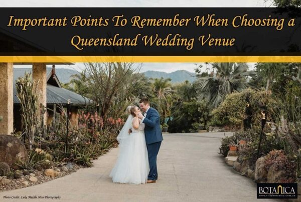 banner image of a newly-wedded couple staring at each other in Villa Botanica waterfront Queensland wedding venue
