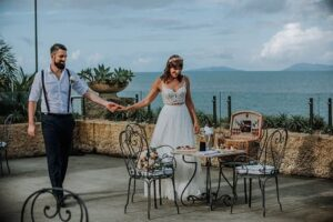 newly wedded couple enjoying Villa Botanica - Garden Wedding Queensland Venue in front coastal views