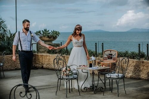 couple with an intimate and romantic reception with breathtaking ocean views - summer outdoor wedding