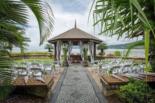 elegant and gorgeous florals perfect for summer outdoor wedding ceremony at the hand caved wedding pavilion - Villa Botanica