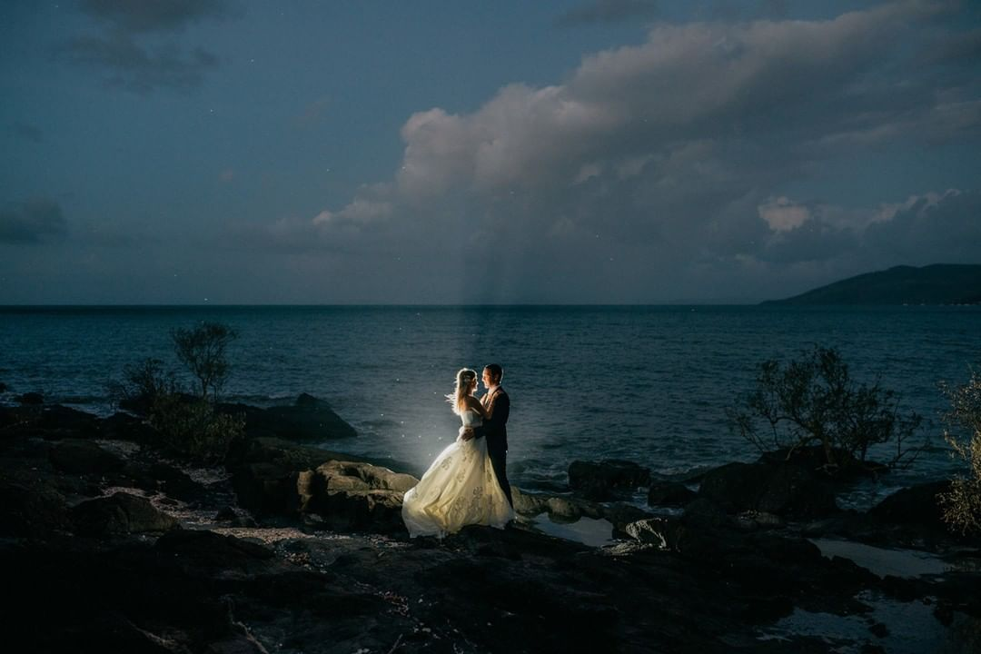 magical moment captured of newly wedded on black rock that is exclusive to Villa Botanica Great for Small Wedding