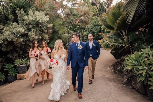 outdoor wedding party strolling with the newly wedded couple and guests at Villa Botanica