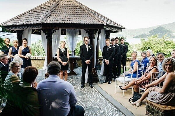 groom with the guests waiting for bride walk down the aisle in Villa Botanica - Whitsunday Wedding Venue