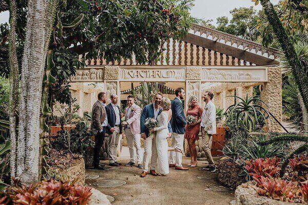 sweet newly wedded couple with the guests in the uniquely beautiful cactarium - Small Wedding Venue of Villa Botanica