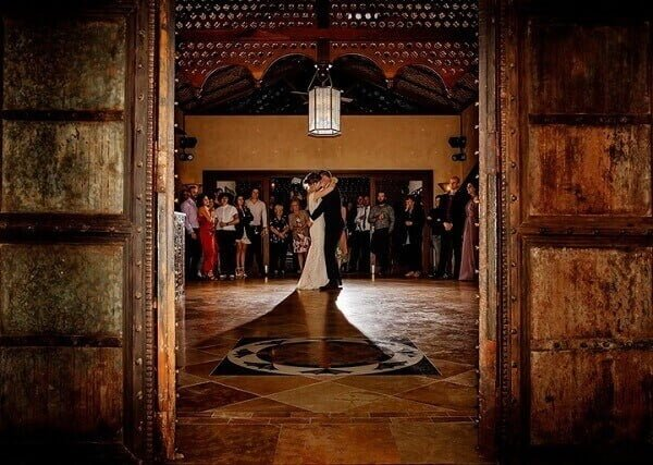 small wedding of newlywed couple first dance as husband and wife on a marble ballroom of Villa Botanica - Whitsunday Wedding Venue Queensland