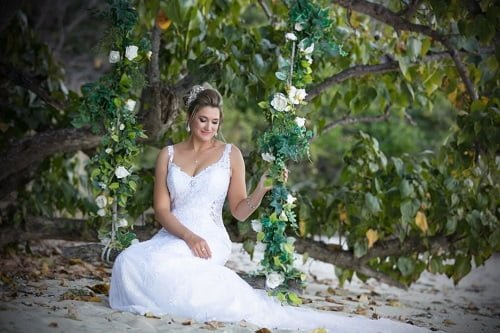 beautiful bride on a beach swing of Villa Botanica Venue Spring Wedding