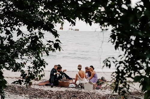 luxury wedding guest having a picnic in front of Villa Botanica's Whitsunday Venue Beach