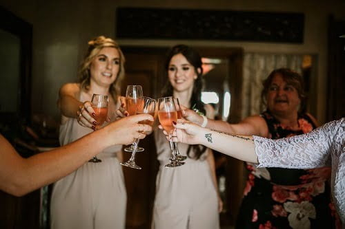 bride to be hosting a toast for bachelorette party before having Spring Wedding